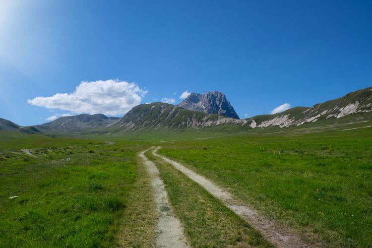 Dirt road that crosses campo imperatore towards the gran sasso abruzzo