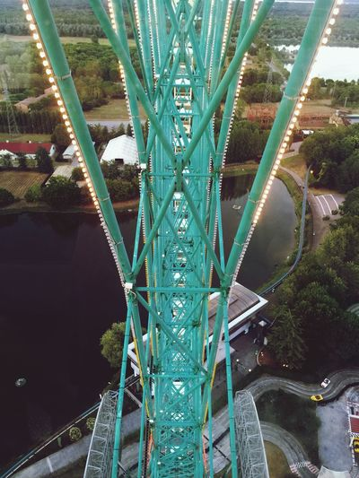 High angle view of rollercoaster at eurowheel by lake