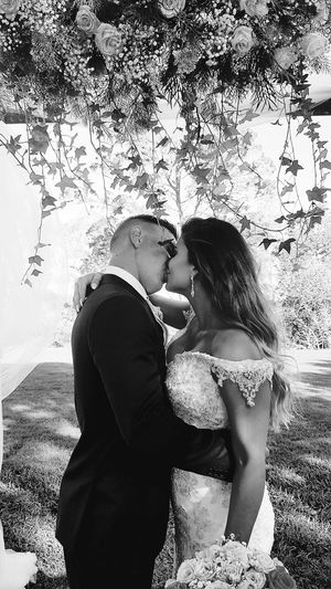 Bride And Groom Wedding Photography Wedding Beachfront Kissing Love Two People Inlove Bestdayofmylife  Flowerarrangement Blackandwhite Togetherness Romance Lovephotography