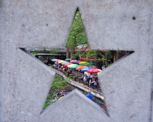 Multi colored parasols seen through star shape