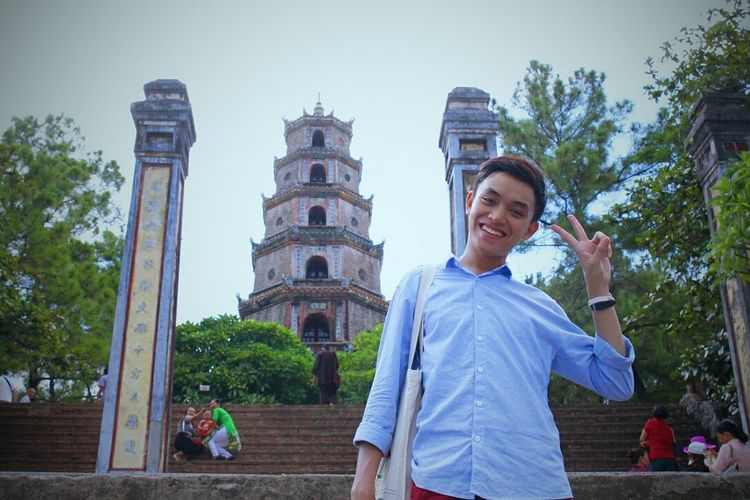 Thien Mu pagoda - Hue, Vietnam Smiling Cheerful Happiness Vietnamese Vietnam Vietnameseboy Travel Destinations Tourism Vacations Travel Architecture Cute Boy Looking At Camera Pagoda EyeEmNewHere