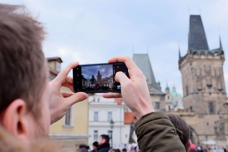 Mobile Phone Prague Taking Photos Tourist Activity Architecture Hand Holding Human Hand Leisure Activity Mobile Phone One Person Outdoors Photographing Photography Themes Real People Smart Phone Technology Tourism Tourist Destination