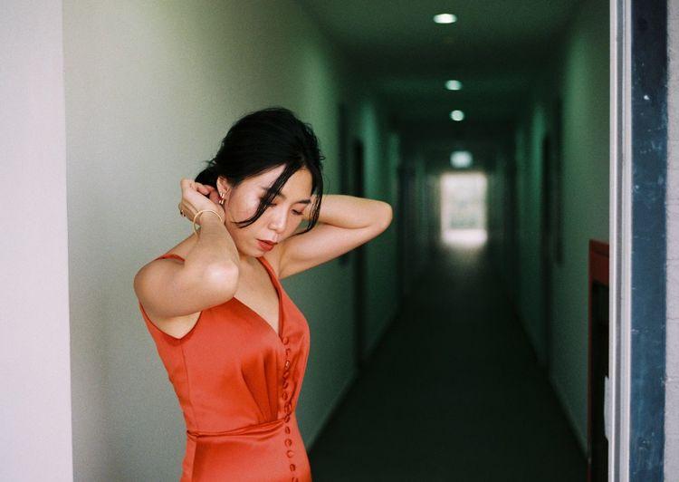 Full length of woman standing in corridor