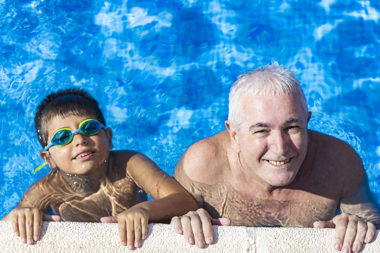 Portrait of smiling man swimming in pool