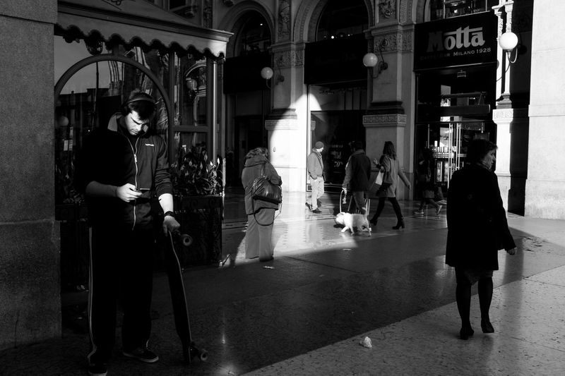 Full length of woman standing in illuminated city