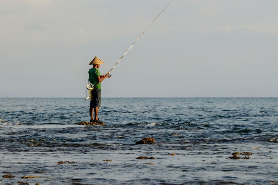 Beauty In Nature Day Fish Fisherman Fishing Fishing Equipment Fishing Industry Fishing Pole Full Length Holding Horizon Over Water Men Nature Occupation One Person Outdoors Real People Scenics Sea Seafood Sky Standing Water Waterfront Working
