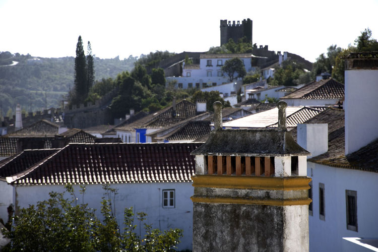 Impressions of the medieval city of Óbidos in Portugal. MedievalTown Obidos Portugal Portugal Architecture Building Exterior Built Structure Clear Sky Day House Medieval Castle Nature No People Outdoors Residential Building Roof Sky Tiled Roof  Tourism Town Tree Óbidos