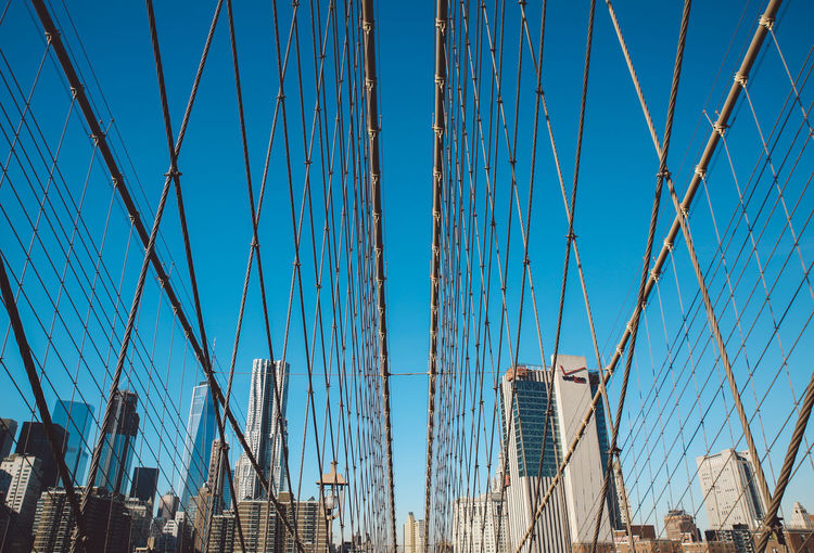 Architecture Architecture Blue Blue Sky Bridge Bridge - Man Made Structure Brooklyn Bridge / New York Building Exterior Built Structure Cable Clear Sky Cold Connection Day Low Angle View Manhattan New York New York City No People Outdoors Sky Steel Cable Suspension Bridge Winter