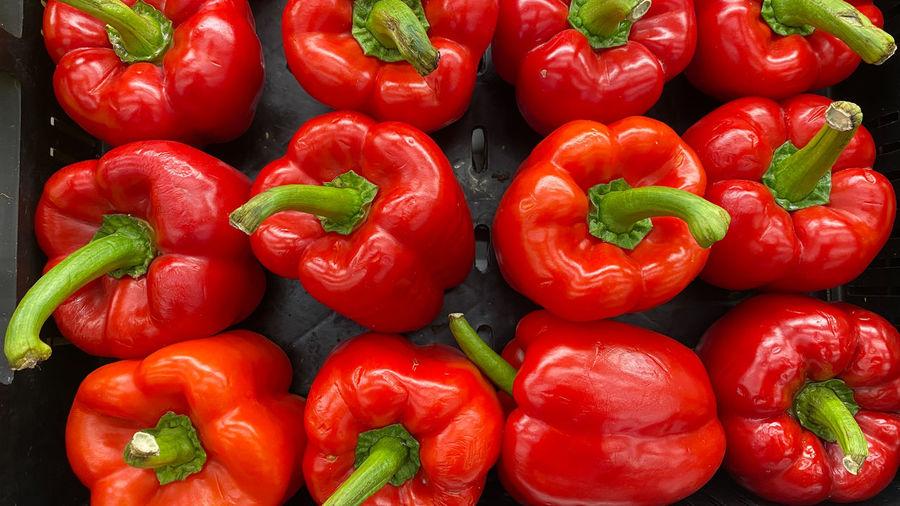 Full frame shot of red bell peppers at market