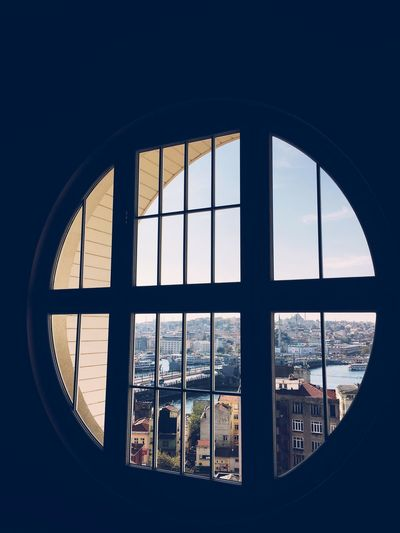 Window Glass - Material Indoors  Built Structure Architecture Looking Through Window Day No People Sky Cityscape Nautical Vessel City Roman Numeral Close-up