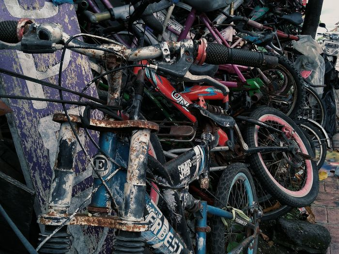 junk and rustic bicycles Bike Bicycle Used Store Wheel Riot Broken Damage Rustic Auction Backgrounds Full Frame Multi Colored Pattern Graffiti Close-up Street Art ArtWork Art And Craft Bicycle Basket Handlebar Bicycle Rack Shattered Glass Craft