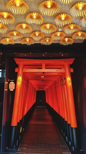 Illuminated corridor of building at night
