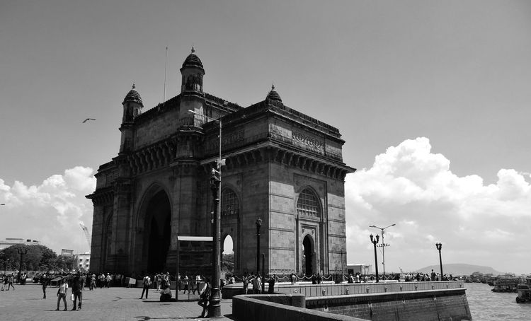 Gatewayofindia Tourist Attraction  Tourist Destination People Travel Destinations Architecture History Sky Outdoors Building Exterior City People Photography Blackandwhite Sky And Clouds Waterfront Oceanside Connected By Travel Lost In The Landscape India Indiaincredible Indianhistory Be. Ready.