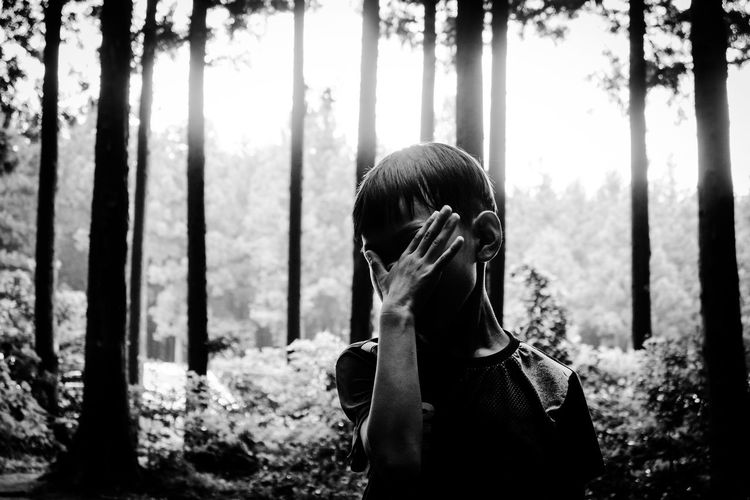 Cover Face Trip Travel Destinations Travel Destinations Traveling Childhood Child Eclipse Body Part Hand Growth Finger Blackandwhite Black And White One Person Day Nature Outdoors Plant Beauty In Nature One Person One Boy Only Forest Portrait Headshot Tree Trunk Woods EyeEmNewHere This Is Natural Beauty The Modern Professional A New Perspective On Life Redefining Menswear My Best Photo
