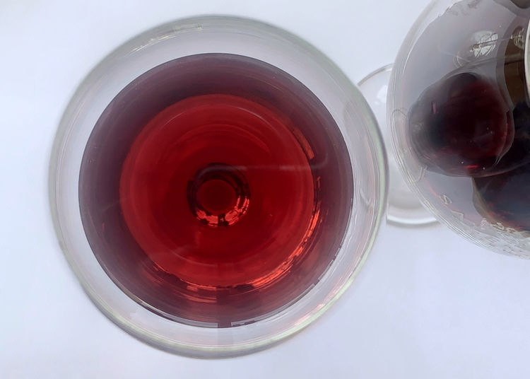 Directly above shot of red wine in glass on table