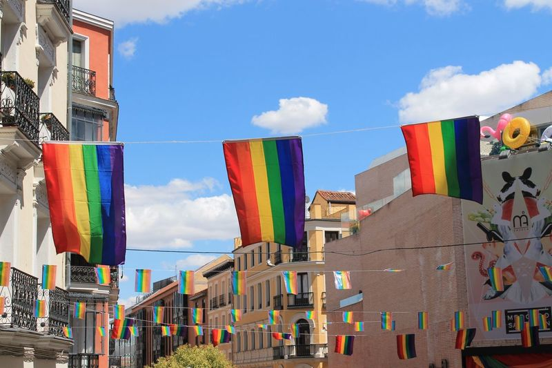 Orgullo Gay 2017 Gay Pride Chueca Madrid Multi Colored Tolerance Cloud - Sky Sky Architecture Building Exterior Built Structure Day Flag Outdoors No People City Celebration Event Celebration Enjoying Life Taking Photos Check This Out Hanging Out Rainbow Flag Flags In The Wind  Flags The Street Photographer - 2018 EyeEm Awards Love Is Love