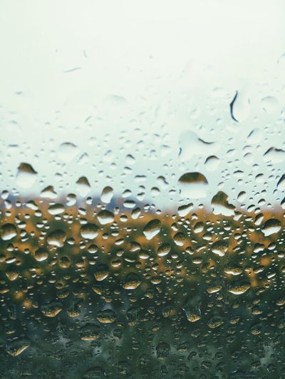 Full frame shot of raindrops on window