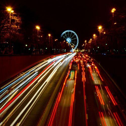 Speeding light trails on road