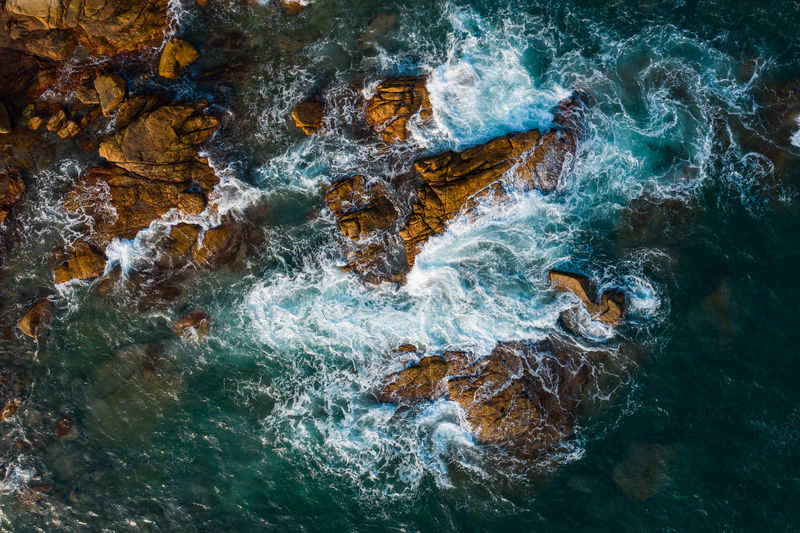 Water Sea Rock Rock - Object Nature No People Motion Beauty In Nature Day Outdoors Waterfront Marine Power In Nature Drone  Aerial View Waves, Ocean, Nature Ocean Rock Seascape Storm Flowing Water Seashore Wave Beach