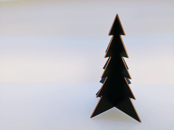 Triangle Shape Christmas Decoration Christmas Tree No People Single Object Tradition Celebration Backround Free Space For Text Close-up Indoors  Studio Shot Christmas Sky Architecture Day Outdoors