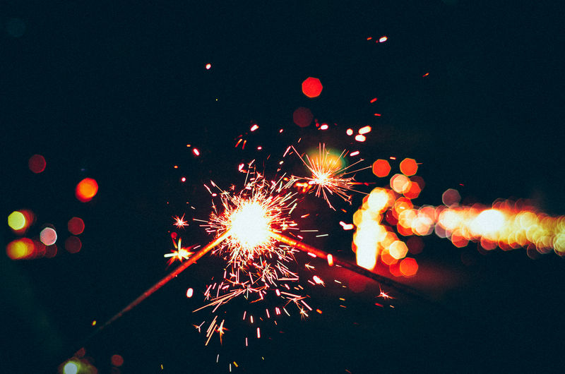 Close-up of sparklers at night