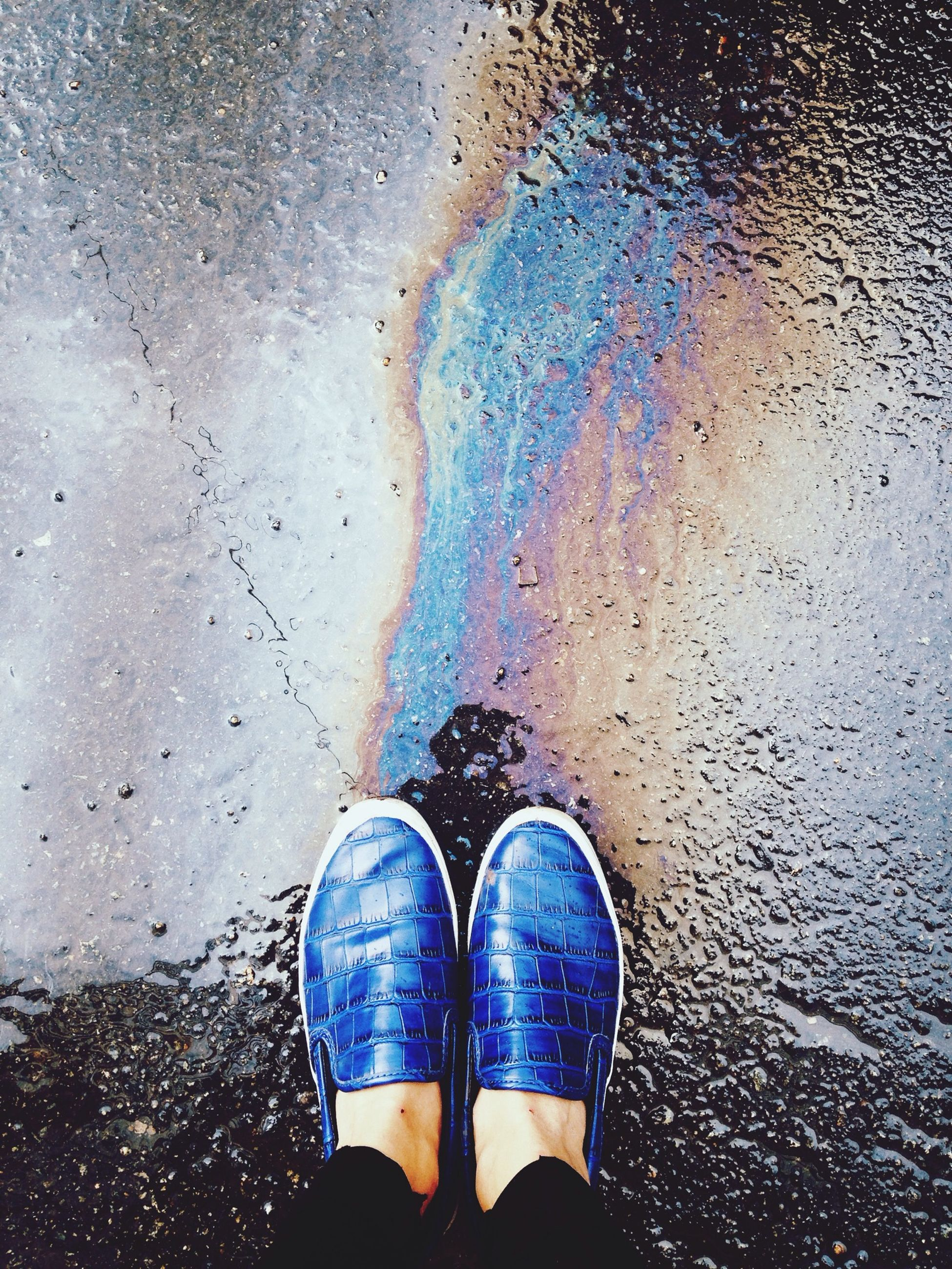 low section, person, water, wet, standing, shoe, lifestyles, street, personal perspective, human foot, rain, reflection, leisure activity, puddle, men, outdoors