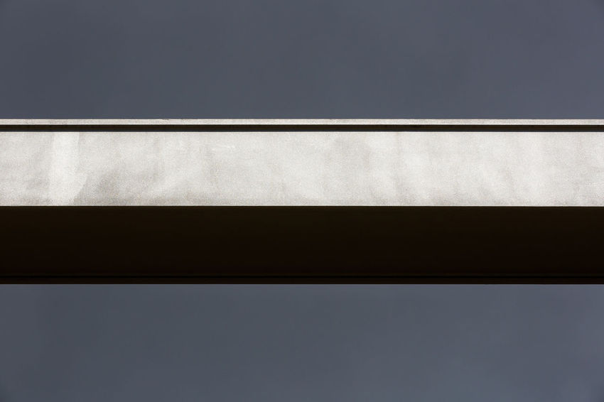 Against The Sky Architectural Column Architecture Built Structure Cloud Column Copy Space Minimalist Architecture Dark Clouds Grey High Section Horizontal Lines Low Angle View Block Stripes Minimalism Part Of Pivotal Ideas Shapes Simplicity Sky Steel Steel Beams Steel Girders Sunny