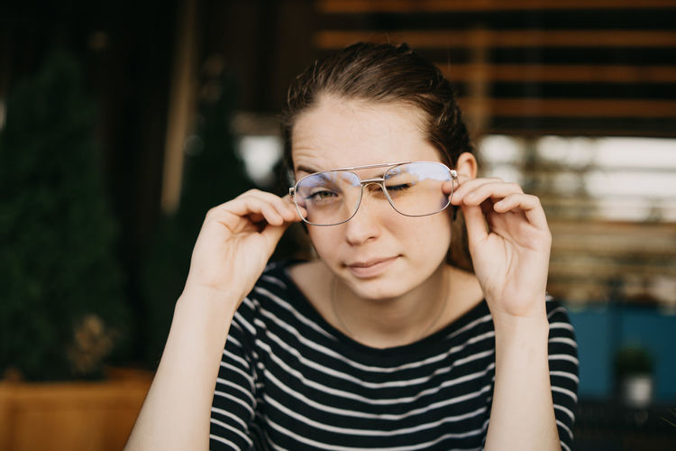 Portrait Of Beautiful Young Woman Wearing Eyeglasses