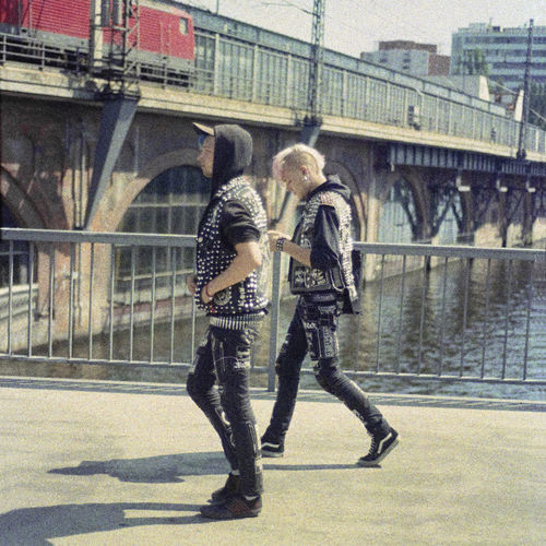 Full length of man standing on bridge in city