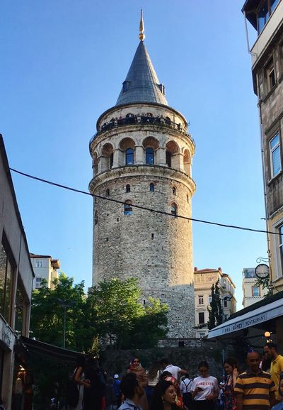 Galata Tower - Istanbul / Türkiye İPhone 6s Plus Iphone6splus IPhoneography Mithatgüney Galata Kulesi Old Istanbul Constantinople Istanbul Galata Tower Built Structure Architecture Building Exterior Sky Building Group Of People Real People Nature Travel Destinations Tourism