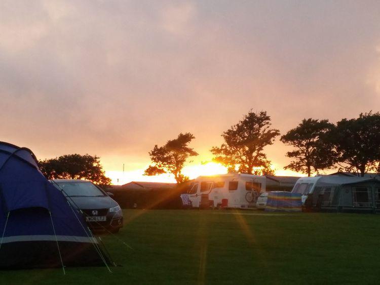 Sunset behind darkened sky Sunset Cloudy