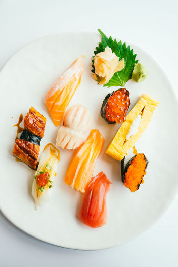 Close-up Day Food Food And Drink Freshness Healthy Eating High Angle View Indoors  No People Plate Ready-to-eat Salmon Salmon - Seafood Seafood Serving Size SLICE Sushi White Background