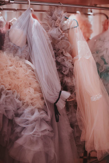 Airy pink girly dresses made of organza on a hanger