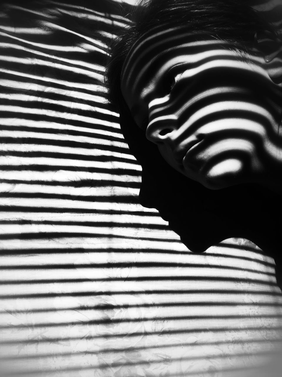 striped, pattern, indoors, zebra, no people, shadow, close-up, bed, day