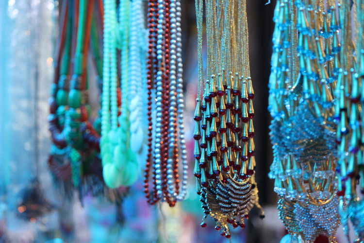 Low angle view of jewelry hanging at market stall