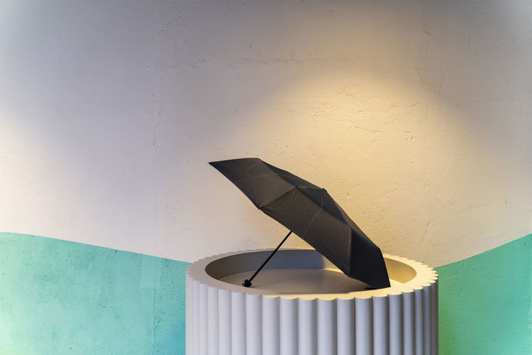 Close-up of lamp against blue wall