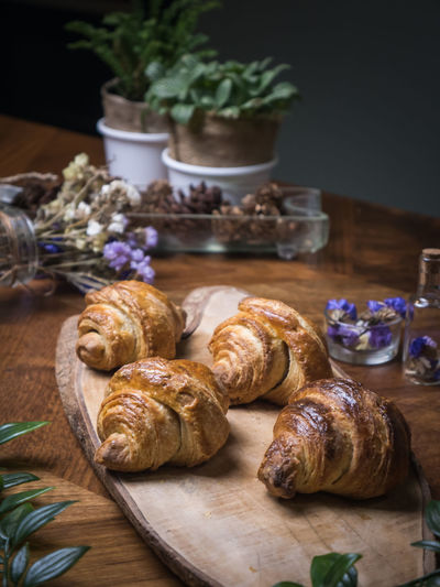Food Food And Drink Freshness Table Still Life Indoors  No People Close-up French Food Baked Wood - Material Wellbeing Croissant Healthy Eating Focus On Foreground Bread Brown Cutting Board Plant Container