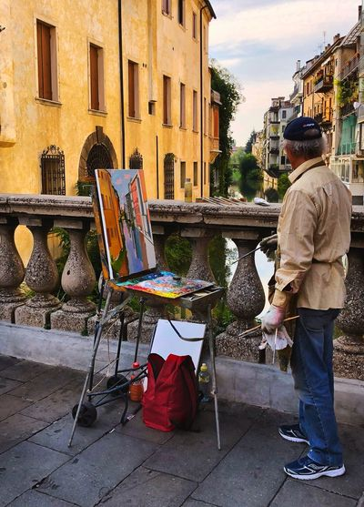 Street art Stretphotography Building Exterior Architecture Built Structure Real People One Person City Street Day Building Men Rear View Seat Lifestyles Full Length Casual Clothing Leisure Activity Standing Outdoors Nature
