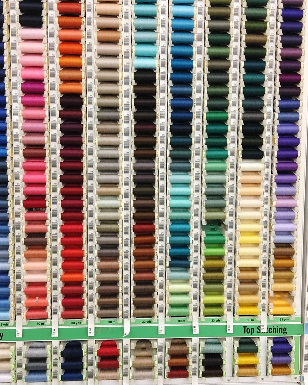 multi colored, full frame, choice, variation, backgrounds, in a row, large group of objects, arrangement, no people, retail, indoors, spool, day, close-up