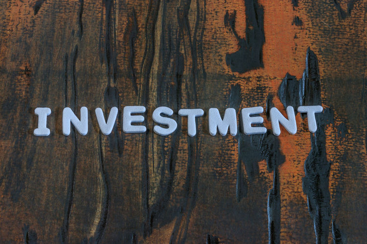 Growth Hope Banking Brown Capital Letter Close-up Communication Day Full Frame Indoors  Investment Managment Metal Money No People Potention Sign Single Word Studio Shot Table Text Textured  Western Script Wood Wood - Material Wood Grain Writing