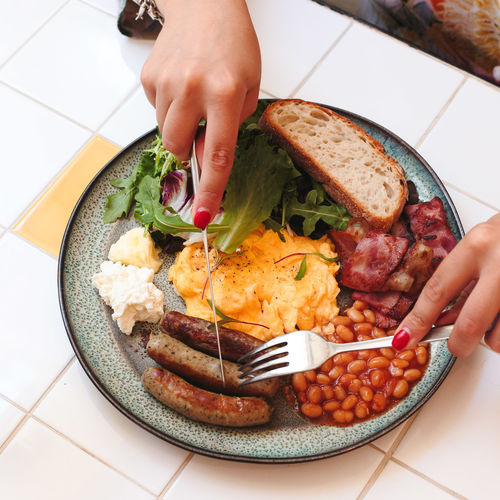 High angle view of people having english breakfast at table