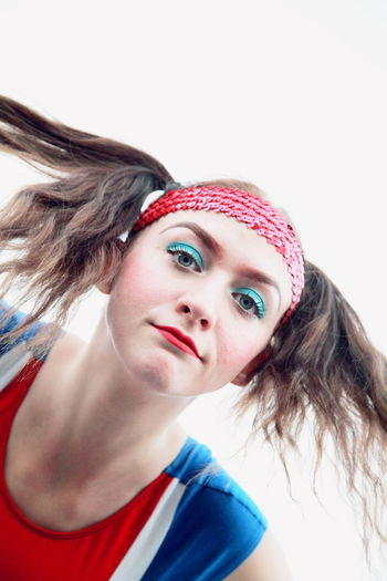 Portrait of young woman wearing headband against clear sky