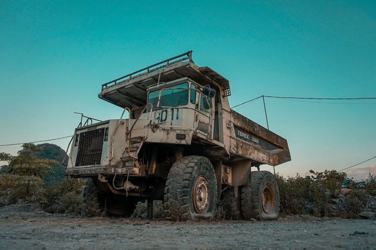 abandoned truck Sky Construction Vehicle Construction Equipment Construction Machinery Mining Construction Site Quarry Earth Mover Bulldozer Road Construction Semi-truck Dump Truck Trucking Pick-up Truck Truck