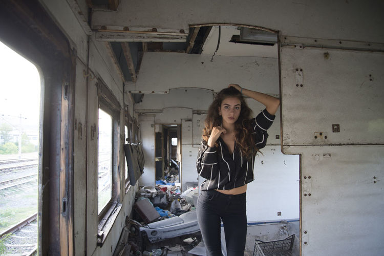 Portrait Of Young Woman Standing In Abandoned Building