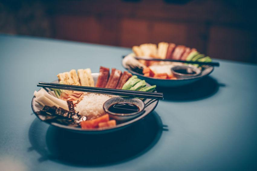 Sushi bowl with salmon, tuna, egg, avocado, radish, rice, nori, ginger and soy sauce DIP Japanese Food Rice Sushi Sushi Bowl Tuna Sashimi Avocado Bowl Chopsticks Egg Food Ginger Indoors  Nori Radish Salmon Soy Sauce Sticks Tuna