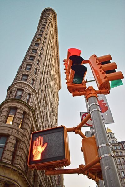 Flatiron Building Flatironbuilding Building Low Angle View Architecture Building Exterior Built Structure City Outdoors Illuminated Communication Day Skyscraper Road Sign No People Travel Destinations Sky Clear Sky Tall NYC Photography NYC NYC Street Photography NYC Street Streetphotography Street Photography