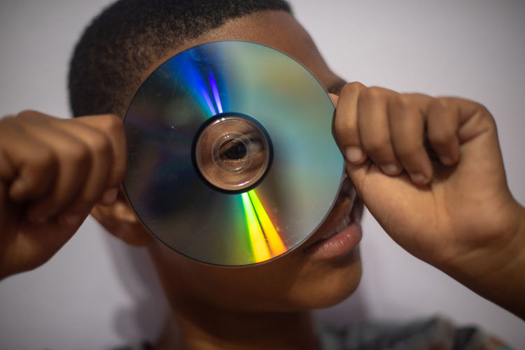 Bulls eye Human Hand Hand Human Body Part Holding Indoors  One Person Men Real People Close-up Body Part Adult Focus On Foreground Lifestyles Midsection Selective Focus Males  Playing Finger Compact Disc