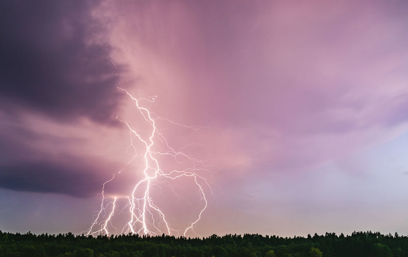 Low angle view of lightning against dramatic sky