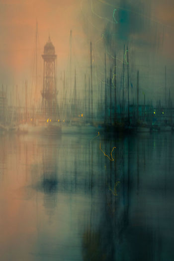 Digital composite image of sailboat in foggy weather