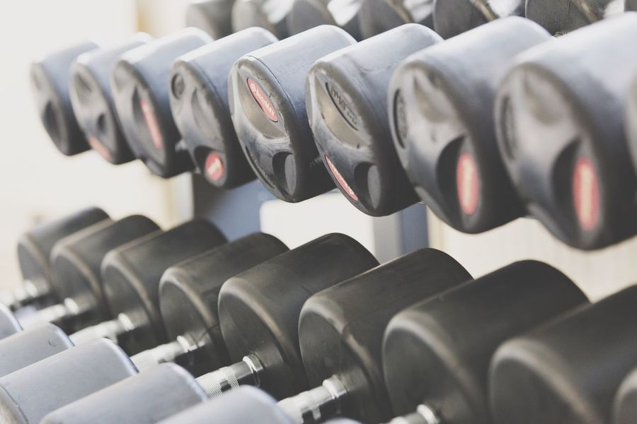 In A Row No People Close-up Gym Indoors  Day Health Club Weights Dumbbell Weights Lifting Heavy Weights Strength Training Gym Equipment In A Row Backgrounds